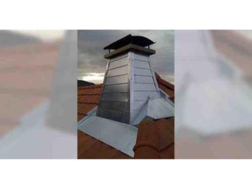 Entourage de cheminée en zinc
